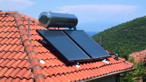 solar panels with water tank on roof